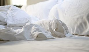 close up of messy bedding sheets and pillow