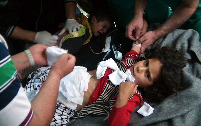 """A handout image released by the Syrian opposition's Shaam News Network shows wounded Syrian children in the town of Qusayr in central Homs province on May 15, 2012. AFP PHOTO/HO/SHAAM NEWS NETWORK --- RESTRICTED TO EDITORIAL USE - MANDATORY CREDIT """"AFP PHOTO / HO / SHAAM NEWS NETWORK"""" - NO MARKETING NO ADVERTISING CAMPAIGNS - DISTRIBUTED AS A SERVICE TO CLIENTS - AFP IS USING PICTURES FROM ALTERNATIVE SOURCES AS IT WAS NOT AUTHORISED TO COVER THIS EVENT, THEREFORE IT IS NOT RESPONSIBLE FOR ANY DIGITAL ALTERATIONS TO THE PICTURE'S EDITORIAL CONTENT, DATE AND LOCATION WHICH CANNOT BE INDEPENDENTLY VERIFIED ---"""