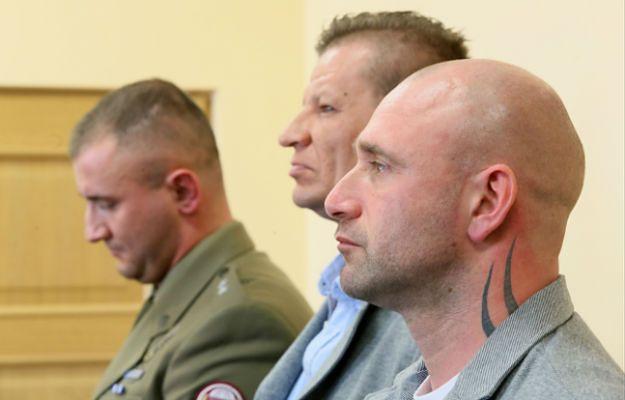 Oskarżeni: st. szer. rezerwy Damian Ligocki, plut. rezerwy Tomasz Borysiewicz i ppor. Łukasz Bywalec podczas ogłaszania wyroku