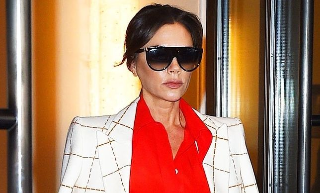 New York, NY  - Fashion Icon and Former Spice Girl, Victoria Beckham causes the paparazzi to go crazy as she is seen leaving a building heading to her car in the Upper Eastside of New York. Victoria looks like a true businesswoman as she dons a gingham suit dress and leopard shoes.  *UK Clients - Pictures Containing Children Please Pixelate Face Prior To Publication*