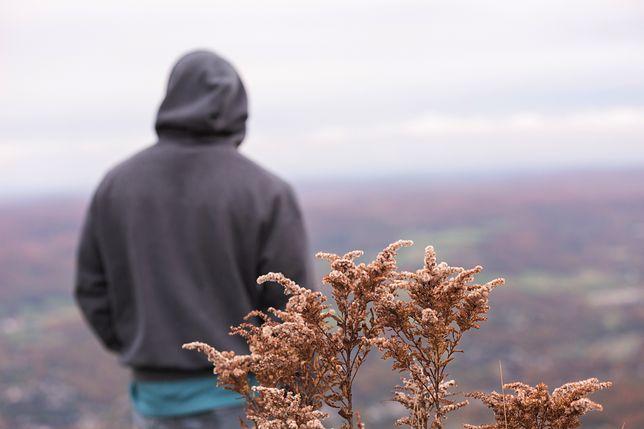 Man's back looking towards mountaing