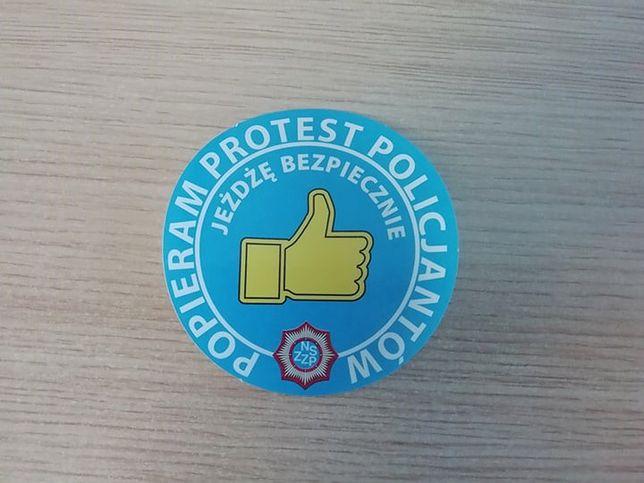 Logo poparcia policyjnego protestu.