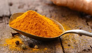 41835042 - ground turmeric in a spoon