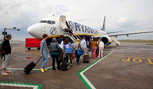 A queue of travelers on the tarmac preparing to board a Ryanair airplane at Stansted Airport in London.