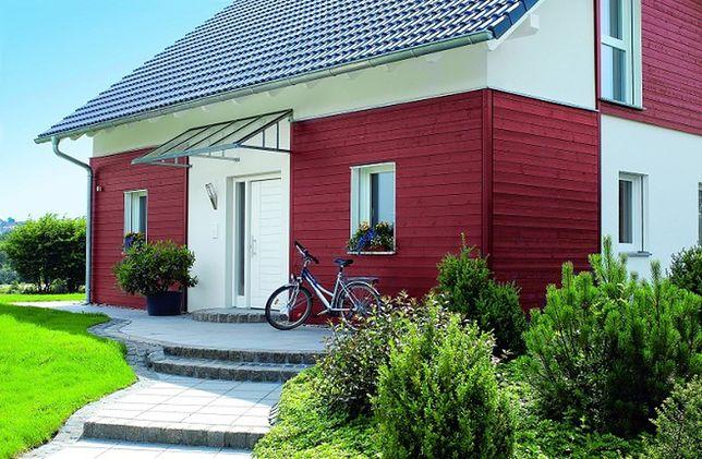 Drewniana elewacja domu. Jak wybrać deski elewacyjne?