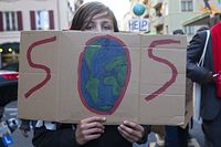 epa09539403 People holding placards attend a Global Climate Strike demonstration during the international strike day of Fridays For Future, in Geneva, Switzerland, 22 October 2021. Global Climate Strike demonstrations are held to demand action from world leaders to combat the climate change crisis.  EPA/SALVATORE DI NOLFI Dostawca: PAP/EPA.