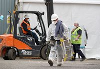 Work continues at the construction of a temporary morgue at an industrial estate in Glasgow as the UK continues in lockdown to help curb the spread of the coronavirus. (Photo by Andrew Milligan/PA Images via Getty Images)