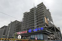 BEIJING, CHINA - AUGUST 18, 2021 - The China Railway and China Dianke Building under construction at Fucheng Road, Haidian District, Beijing, August 18, 2021. China Railway said on August 17 that it has completed five modern mines in China and abroad, including Luming Molybdenum Mine in Heilongjiang, Green Silk Copper and Cobalt mine in Congo (Gold), MKM Copper and Cobalt mine in Congo, SICOMINE Copper and cobalt mine in Huagang and Wulan Lead and zinc mine in Mongolia. (Photo credit should read Costfoto/Barcroft Media via Getty Images)