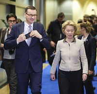 BRUSSELS, BELGIUM - FEBRUARY 6: Polish Prime Minister Mateusz Morawiecki (L) is welcome by the President of the European Commission Ursula von der Leyen (R) prior to a bilateral meeting in the European Commission on February 6, 2020 in Brussels, Belgium. (Photo by Thierry Monasse/Getty Images)