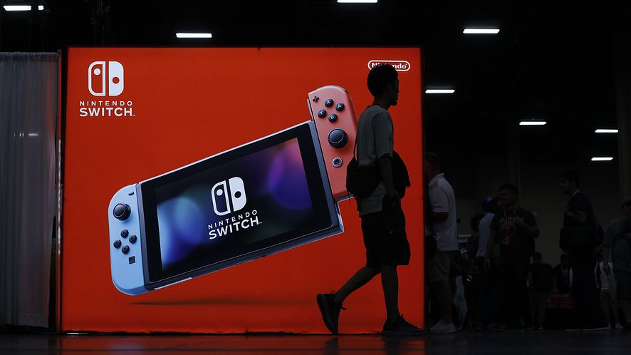 LAS VEGAS, NEVADA - AUGUST 02: Attendees walk by the Nintendo booth during day one of the 2019 Evolution Championship Series at Mandalay Bay Resort and Casino on August 02, 2019 in Las Vegas, Nevada. (Photo by Joe Buglewicz/Getty Images)
