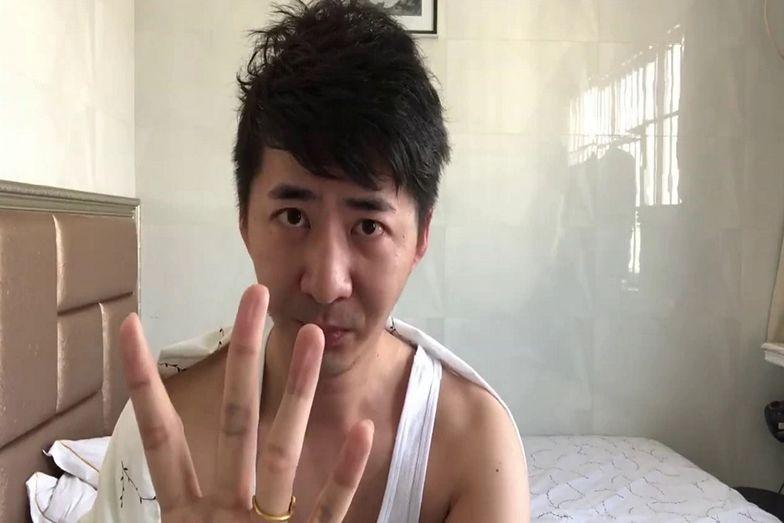 """Chiny. Kontrowersyjny dziennikarz został poddany """"kwarantannie"""""""
