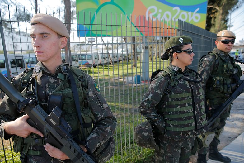 Military personnel stand guard outside the 2016 Rio Olympics Village in Rio de Janeiro, Brazil, July 27, 2016.    REUTERS/Damir Sagolj